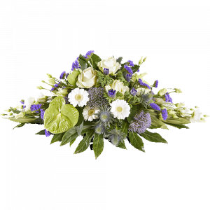 Funeral arrangement with white and purple flowers