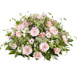 Round funeral arrangement made with pink flowers