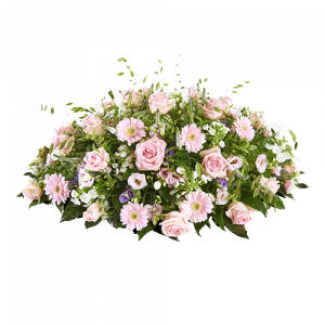 Oval funeral arrangement with mainly pink flowers