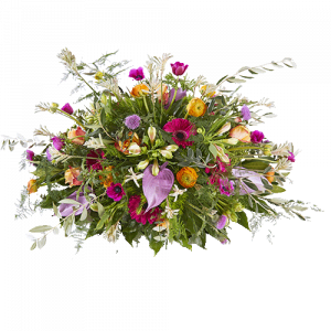 Oval funeral arrangement made with flowers in many colours, it is called 'Beloved'.