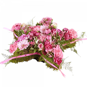 Funeral arrangement with pink flowers in the shape of a star, for the funeral of a child.