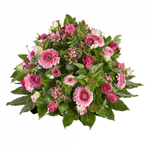 Round funeral arrangement with pink flowers