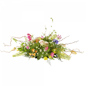 Oval funeral arrangement with bright seasonal flowers