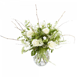 Luxurious white funeral bouquet in vase