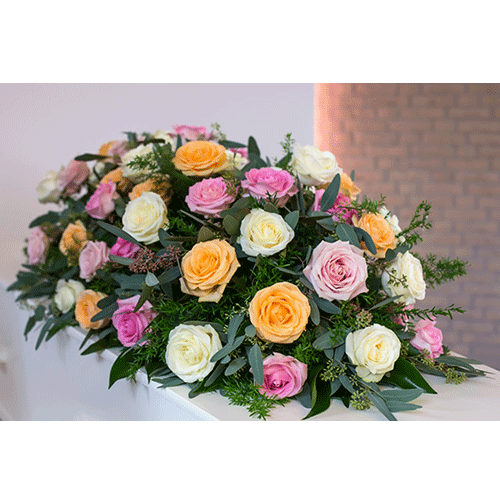 Coffin flowers with roses in several colours