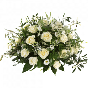 Round white funeral arrangement with roses