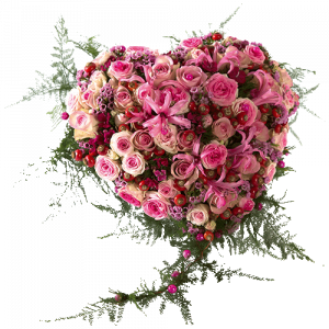 Funeral heart with several pink flowers