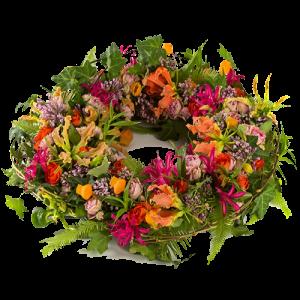 Rouwkrans met veel verschillende kleuren bloemen