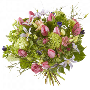 Lively spring bouquet with pink tulips and several other flowers in soft shades