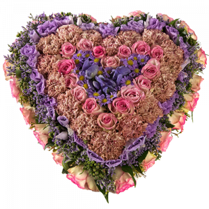 Funeral arrangement in the shape of a heart with pink and purple flowers
