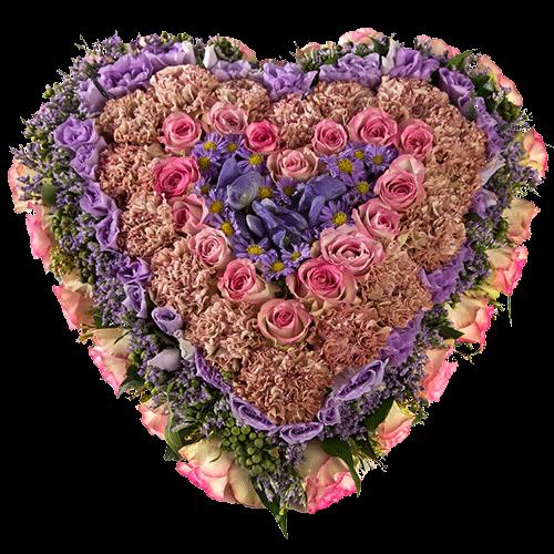 Rouwarrangement hart met verschillende kleuren bloemen