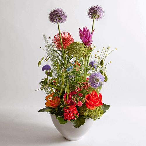 Vrolijk kleurrijk bloemstuk 'Waar is dat feestje'