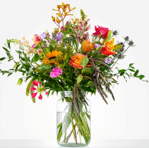 Beautiful picked bouquet with flowers in different colors